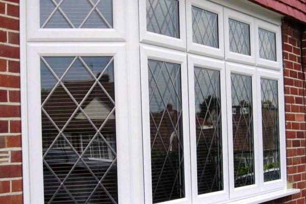 White framed leaded windows