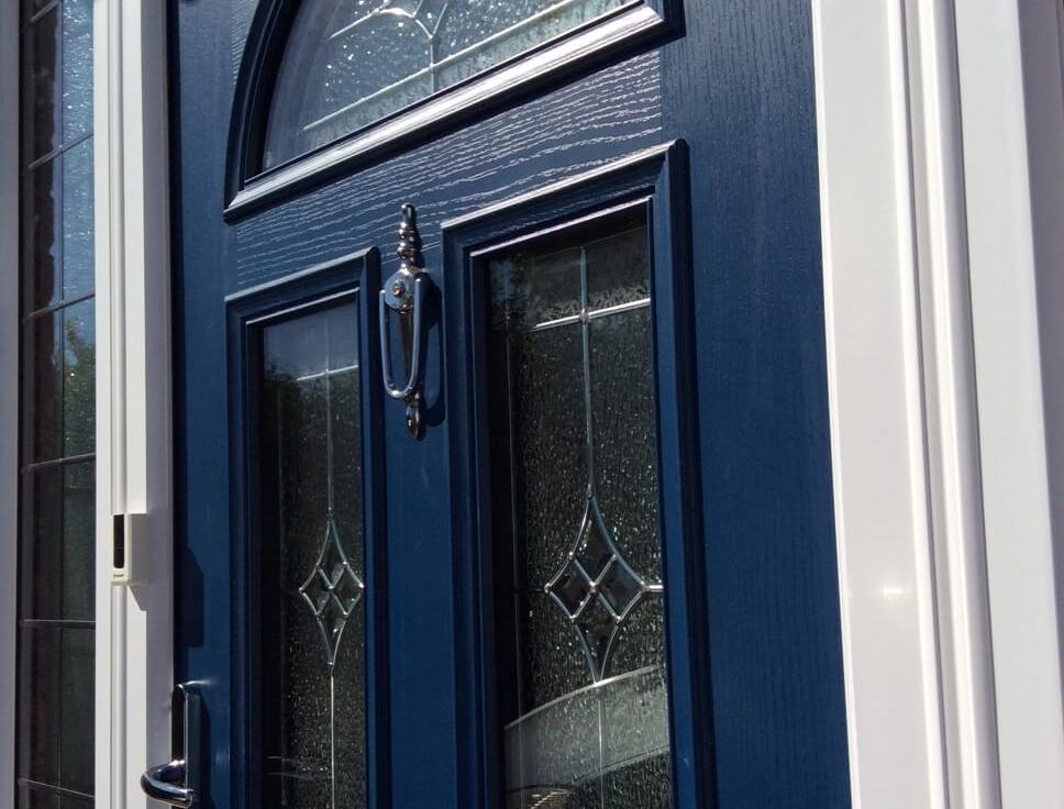 Blue entrance doors with patterned windows