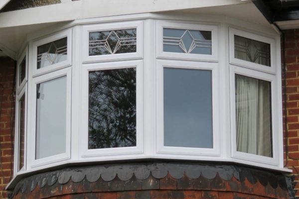 White framed bay windows