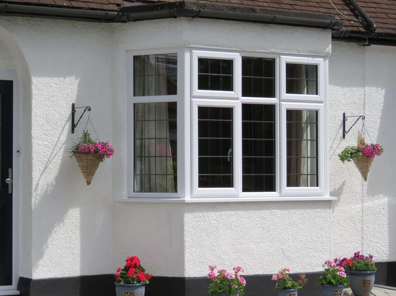 White framed windows on white facade