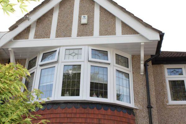 White framed bay windows