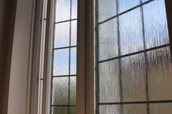 Close view of ajar window from the windowsill