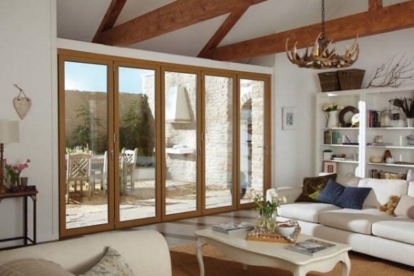 Wood framed bi-fold doors at edge of living room