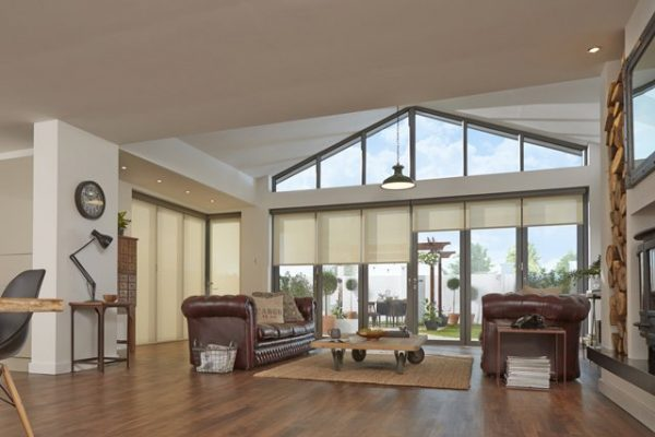 Large living room with b-fold doors at the rear