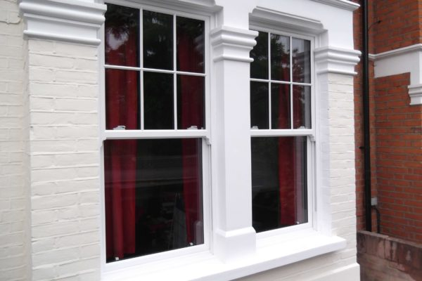 exterior windows on white facade