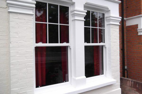White framed windows on a white facade