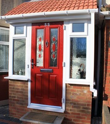 Red porch door with decorative window