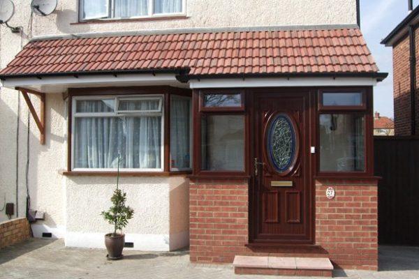 Brown porch door with detailed window