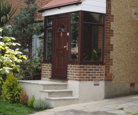 Brown framed porch doors on an angle